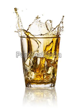 splash in glass of whiskey