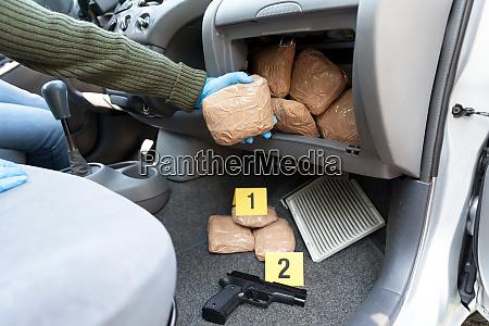 police officer holding drug package found