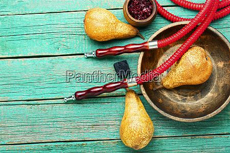 smoking hookah with pear