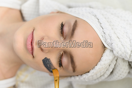 face mask being applied on womans