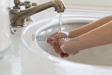 close upof girl 6 7 washing