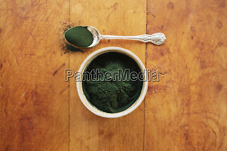 spirulina in bowl and spoon full