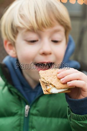 cute boy 4 5 eating cracker