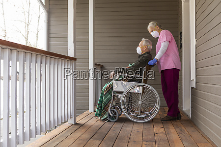 woman and man in wheelchair wearing