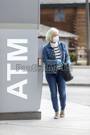 woman wearing gloves and mask to