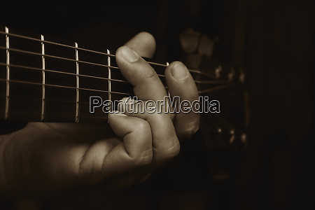 acoustic guitar player performing guitarist playing