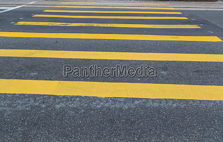 yellow crosswalk on asphalt