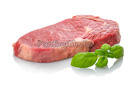raw beef steak entrecote with green