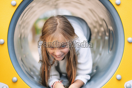 pretty little girl having fun crawling