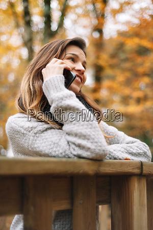 smart phone autumn woman talking on