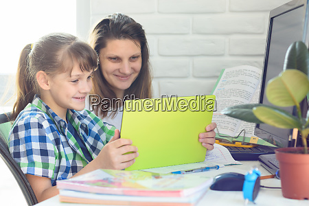 mom and daughter communicate via video