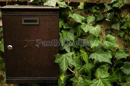 brown mailbox set up on concrete