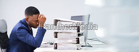workaholic businessman with headache and stress