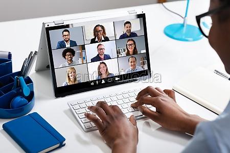 businesswoman using laptop preparing invoice