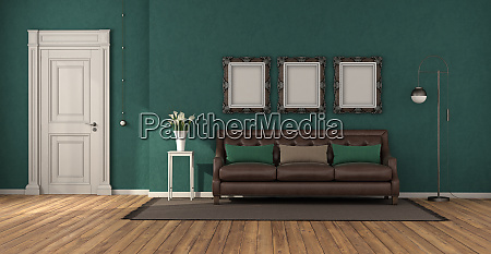 green classic living room with leather