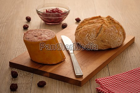 liver sausage with roll on wooden