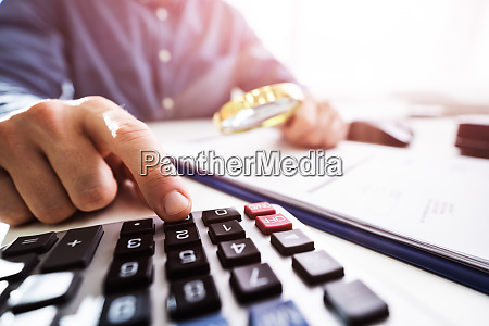 businessperson, inspecting, financial, data - 28300658