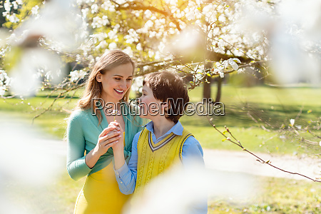 son giving his mom flowers for