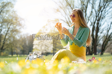 beautiful woman sitting on a spring