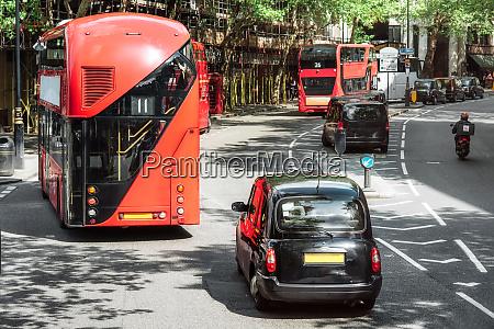 london road traffic double decker buses