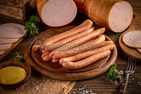fresh sausages served with mustard
