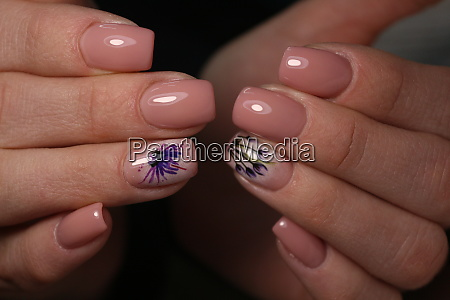 partial view of manicurist gently holding