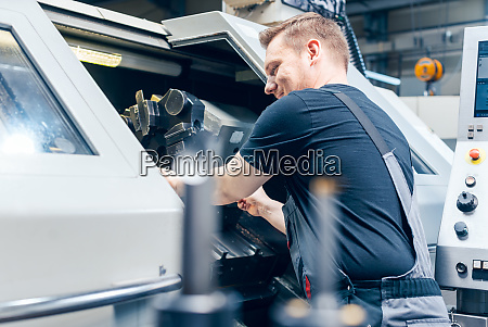 experienced worker changing tool setup of