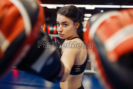 woman in gloves boxing in the