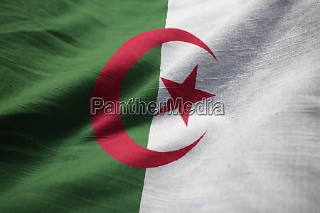 ruffled flag of algeria blowing in