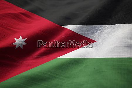 closeup of ruffled jordan flag jordan