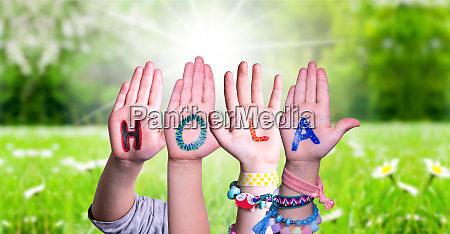 kids hands holding word hola means