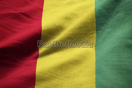 closeup of ruffled guinea flag guinea
