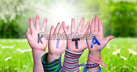 children hands building word kita means