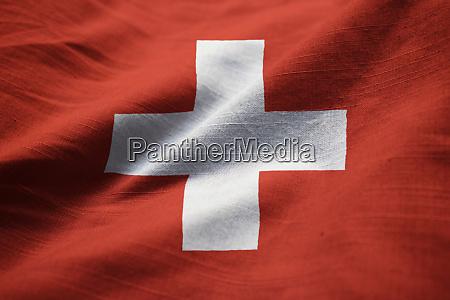 closeup of ruffled switzerland flag switzerland