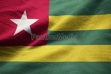 closeup of ruffled togo flag togo