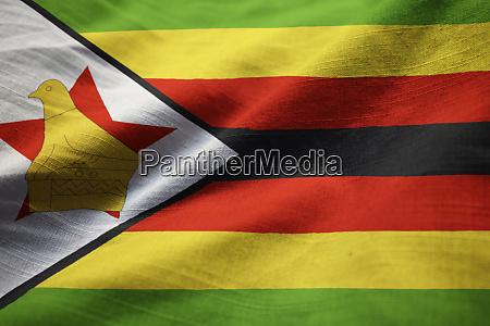 closeup of ruffled zimbabwe flag zimbabwe