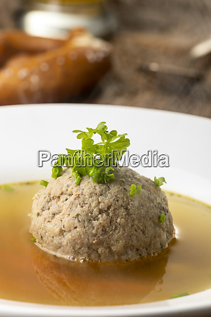 bavarian liver dumpling soup on wood