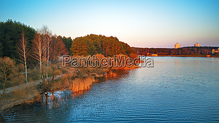 lakeside with colorful trees in spring