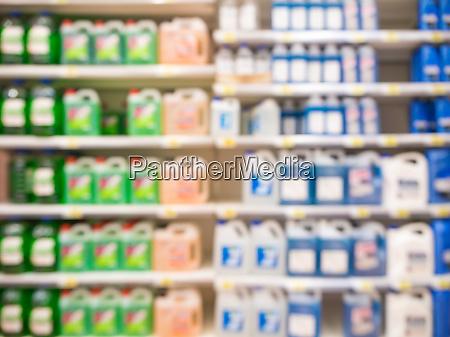 blurred motor oil on shelves in