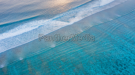 aerial view of calm waves breaking