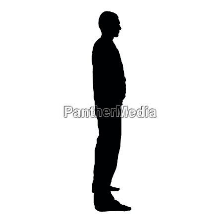 man stands dressed in work clothes