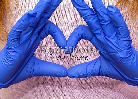 girl wearing blue latex gloves for