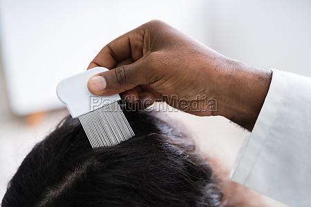 doctor doing treatment on hair
