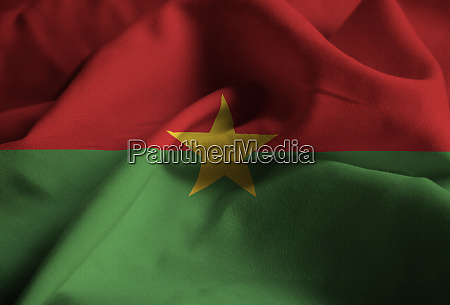 ruffled flag of burkina faso blowing
