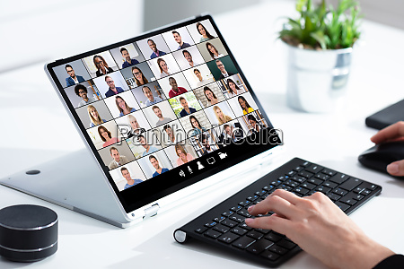 woman selecting new house on laptop