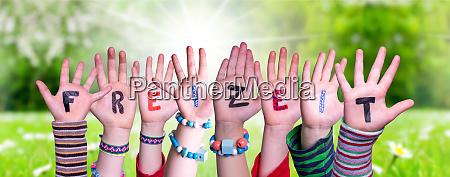 children hands building word freizeit means