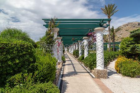 path with pergola and mosaic pavement