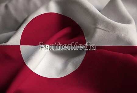 closeup of ruffled greenland flag greenland