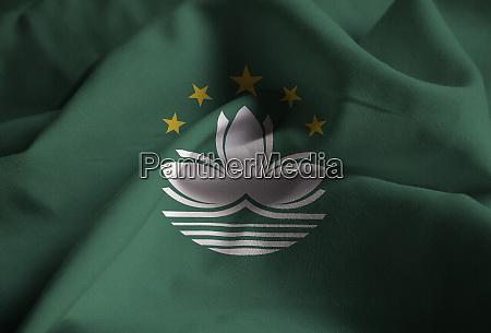 closeup of ruffled macau flag macau