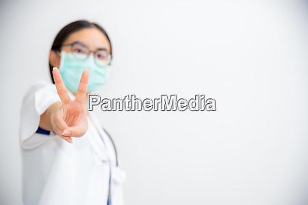 doctor raise two v shape finger